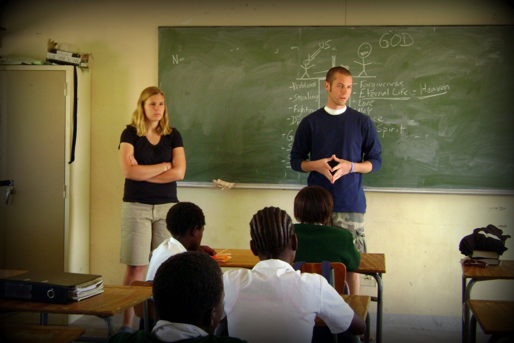 Teaching a classroom full of students in Rundu, Africa.